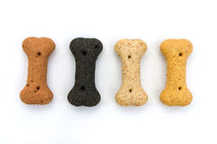 Line of dog biscuits over white Stock Images