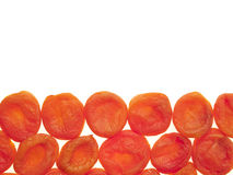 The line of dried apricots. Royalty Free Stock Images