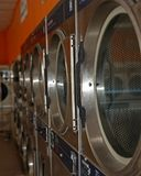 Line of dryers. In a laundromat Royalty Free Stock Image