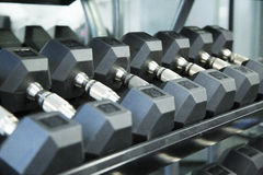 A line of dumbbells on the rack at the gym Stock Image