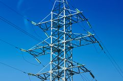 Line of electrical transmission, high metal poles with electric. Electric transmission lines supply electricity to residential and industrial areas from power Stock Photos