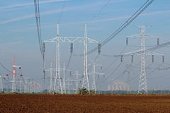 Line of electricity pylons and nuclear power plant Stock Images