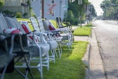 Line of empty chairs set up for fourth of July parade stock photos