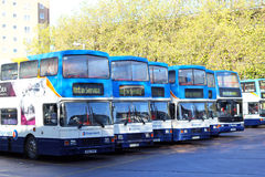 Line of empty double decker buses. Stock Photos