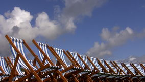 Line of empty folding chairs outdoors Royalty Free Stock Photo