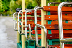 A line of empty red seats. On a rainy day Royalty Free Stock Images