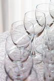 Line of empty wine glasses. Wine glasses served at the restaurant on white tablecloth Royalty Free Stock Images