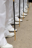 Line of feets and swords. A line of navy soldiers during a parade Stock Photo