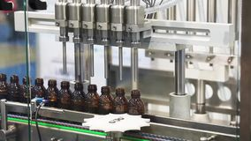 In-line filler machine. For liquid, viscous and cream products stock video footage
