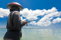 Line fishermen Stock Images