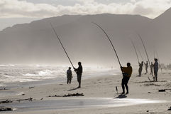 Line fishing from a beach Stock Photo