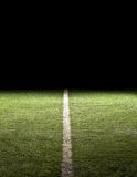 Line on a Football Field at night. The boundary line or goal line on a football field. Dramatic lighting stock photography