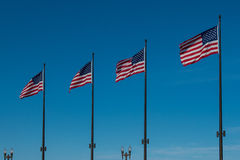 Line of Four American Flags Waving on Blue Sky. In downtown Chicago Stock Images