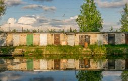 A row of garage doors reflecting in water. royalty free stock image
