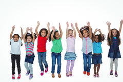 Line of girls standing with arms raised Stock Images