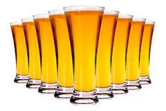 Line of glasses with lager beer Stock Photo