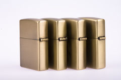 Line of gold lighters. Some line of gold lighters on white background stock images