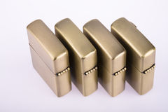 Line of gold lighters Royalty Free Stock Photo