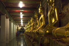 Line of golden statues royalty free stock images