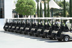Line of golf carts. At upscale resort in sunny Arizona Royalty Free Stock Photos