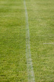 The line on the grass on the football pitch Stock Images