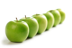 Line of green apples Stock Image