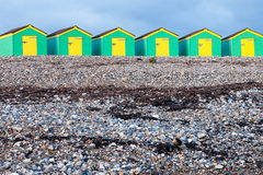 Line of Green and Yellow Beach Huts Stock Image