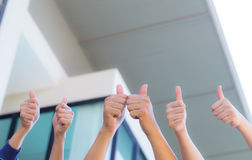 Line of group of human fists giving thumb up. Office background - teamwork  business concept Royalty Free Stock Photography