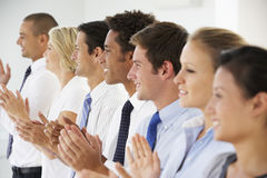 Line Of Happy And Positive Business People Applauding Royalty Free Stock Photos