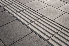 Line of tactile paving along the edge of platform at the train s Royalty Free Stock Images