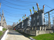Line of high voltage electric converters. Equipment at a power plant Royalty Free Stock Photo