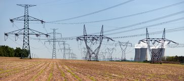 Line of high voltage electricity and nuclear power plant Royalty Free Stock Images