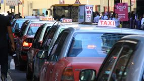 A line of Hong Kong taxis waiting in queue stock video footage