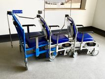 Line of hospital wheelchairs. Row of hospital wheelchairs at entrance to royalty free stock image