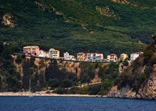 Line of houses in Parga, Greece. With the beach downiside stock photos