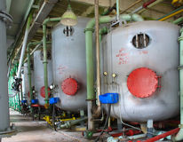 Line of industrial chemical tanks at power plant Royalty Free Stock Photos