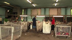 OLOMOUC, CZECH REPUBLIC, APRIL 25, 2018: Line for industrial sorting of different types of plastics waste. Poor and. Line for industrial sorting of different stock video