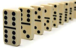 Line of Ivory Dominos. Close up of chain of Ivory Domino Tiles Royalty Free Stock Image