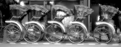 A line of Japanese pushcarts parked on a street in black and white. A line of Japanese pushcarts parked on a street in front of a restaurant in black and white Royalty Free Stock Photography