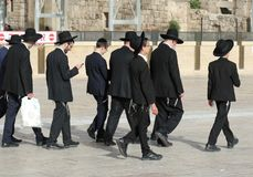 Line of Jewish men in Israel. JERUSALEM, ISRAEL - MAY 25, 2018: Group of black hat group of ultra orthodox Jewish men from chabad lubavitch movement in Jerusalem royalty free stock photo