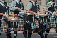 Line of kilted drummers. Royalty Free Stock Photos