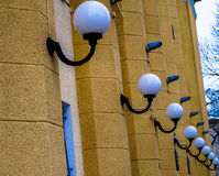 Line of lanterns against the walls of  houses in the city Stock Photography
