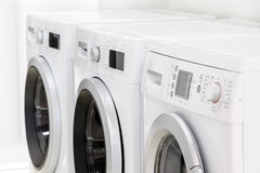 Line of laundry machines Stock Image