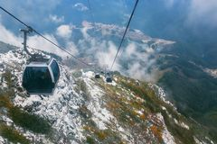 Line of lifts in high mountains. Line of lifts in picturesque high mountains Royalty Free Stock Photos