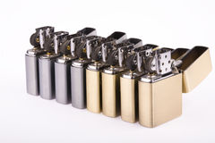Line of lighters. Some line of lighters sits open on white background royalty free stock images
