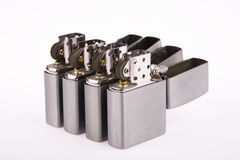 Line of lighters. Some line of  lighters sits open on white background stock photo