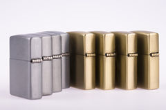 Line of lighters. Some line of lighters sits open on white background stock photos
