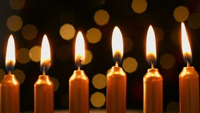 Line of lighting golden candles stock video footage