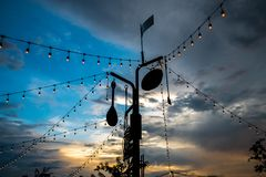Line of lights festive decorations in the restaurant with twilight sky background. stock photo