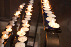 Line of lit candles Stock Photography